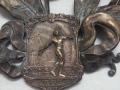 ramo di alloro - Trieste 1922 (dettaglio)